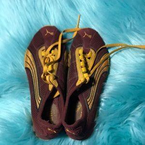 Puma gold and burgundy 4.5